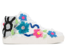 Sneakers mit floralen Verzierungen