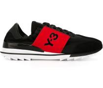 Sneakers mit kontrastierendem Logo-Einsatz
