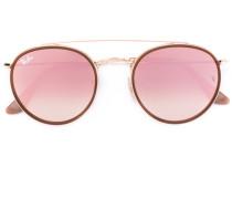 Runde Sonnenbrille mit rosa Gläsern