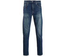stonewashed slim-fit jeans