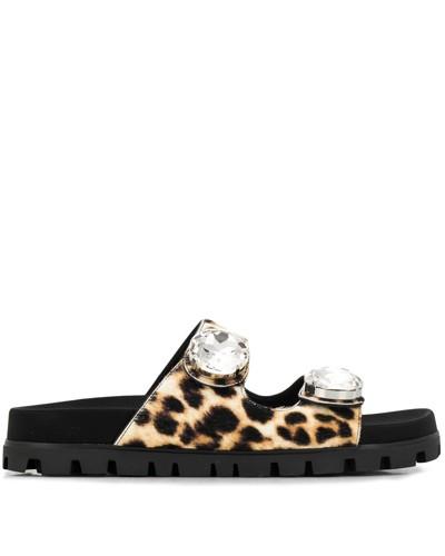 Verzierte Pantoletten mit Leopardenmuster