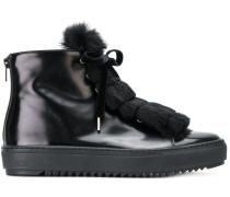 Sneakers mit Pelzbesatz
