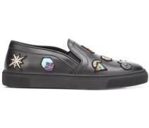 Slip-On-Sneakers mit aufgestickten Patches