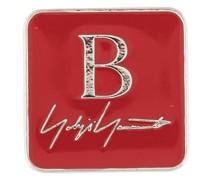 Brosche mit Logo