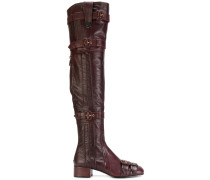 thigh-high buckle boots