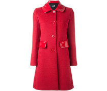 Mantel mit glänzenden Details