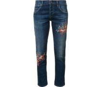 Jeans mit aufgestickten Blumen