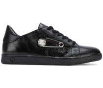safety pin embellished sneakers