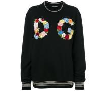 Pullover mit floralem Logo