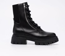 zipped-up combat boots
