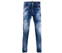 Skinny-Jeans mit Farbklecksen