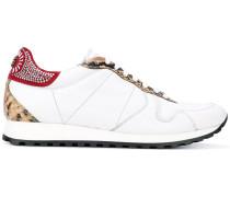 Sneakers mit Einsätzen in SchlangenlederOptik