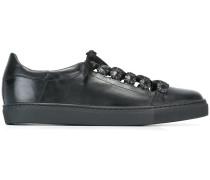 Verzierte Sneakers mit Ösen
