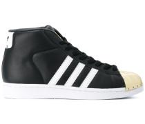 High-Top-Sneakers mit goldfarbener Schuhspitze