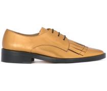 fringed lace-up shoes
