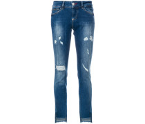 distressed high low raw hem skinny jeans