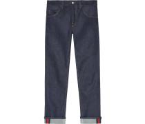 Dunkelblaue Jeans mit abgeschrägtem Bein und Webstreifen