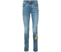 Skinny-Jeans mit aufgestickten Blumen