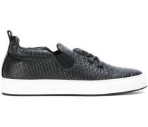 Slip-On-Sneakers mit Totenkopf-Applikation