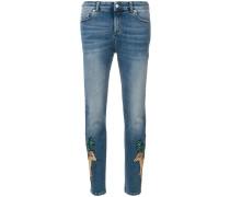 animal patch skinny jeans