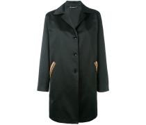 Mantel mit verzierten Taschen