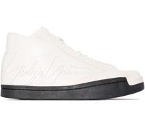 Sneakers mit Wildlederbesatz
