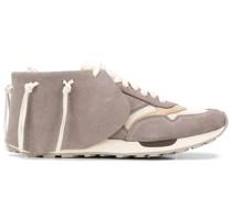 Sneakers im Mokassin-Stil
