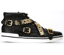 Sneakers mit Schnallen