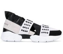 Sneakers mit Applikationen