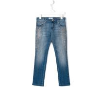 Jeans mit Medusa-Nieten