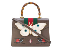 Leather top handle bag with moth