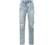 x Travis Scott Jeans im Distressed-Look