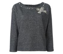 Pullover mit Schleifenapplikation