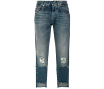 deconstructed logo patch jeans