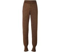 tapered ruffle cuff trousers