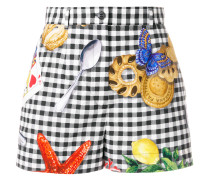 checkered print shorts with motif prints