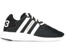 Sneakers mit seitlichen Schleifen