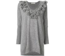 oversized jumper with crochet tassel neckline
