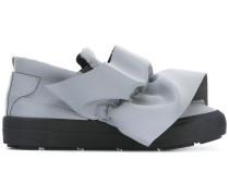 Sneakers mit Besatz
