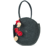 weaved round tote bag with pom-poms