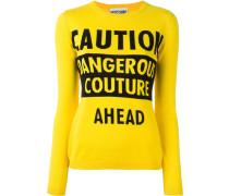 caution dangerous couture jumper