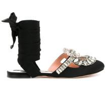 Sandalen mit silberfarbenen Verzierungen