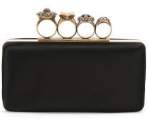 Clutch mit verzierten Ringen