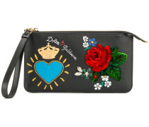 print and appliqué clutch bag