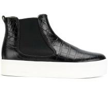 crocodile-effect chelsea boots