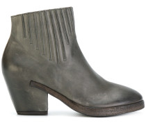 curved ankle boots