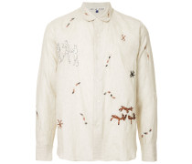 embroidered caveman shirt