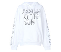 hissing at the sun hoodie