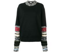 Pullover mit grob gestrickten Ärmeln