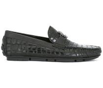 Schuhe mit Krokodilledereffekt